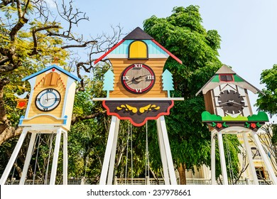 A clock house and swing in park