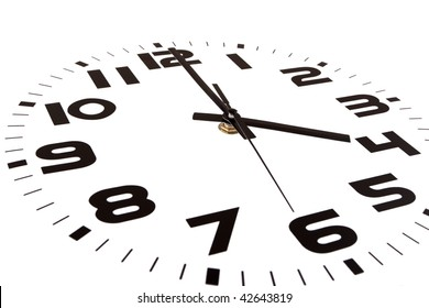Clock isolated on white marking the four o'clock hour. The main focus is in the hour hand.