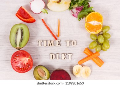 Clock made of fresh ripe fruits and vegetables containing natural minerals and vitamins, time to diet and healthy eating concept