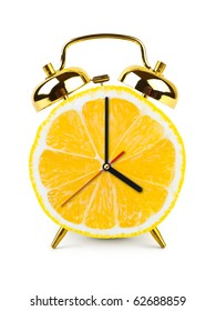 Clock made of fruit isolated on white background