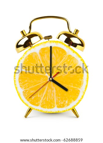 Clock made of fruit isolated on white background