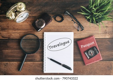 clock, magnifying glass, camera, passport, compass and notebook with TRAVELOGUE word. travel concept