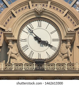 Clock at the main portal of Keleti pályaudvar (train station) in Budapest, Hungary. Black fingers and numbers on white clock face. Time on clock: 03h53