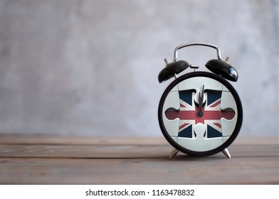 Clock with missing piece from a jigsaw piece british flag