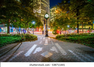 Clock and modern buildings in Uptown Charlotte, North Carolina.
