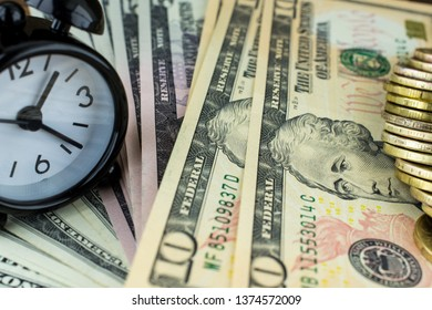 Clock and money , finance and time for business. Macro photo.