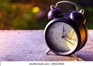 Clock at noon and beautiful light