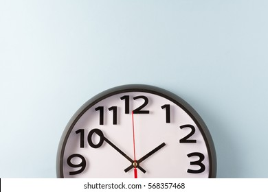 Clock on blue wall