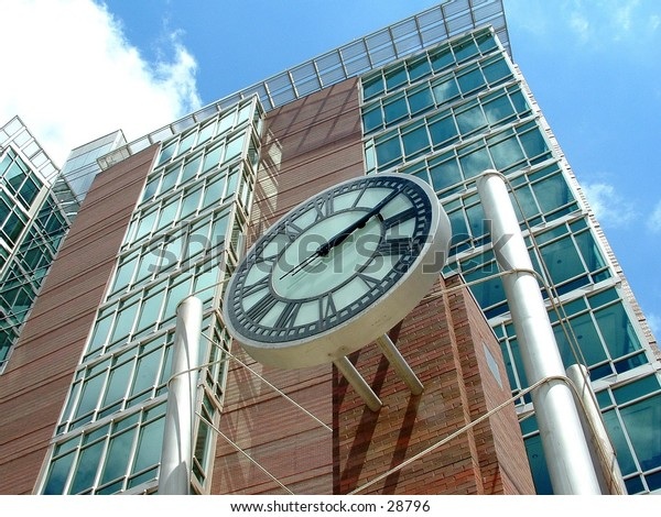 clock on a building in downtown Grand Rapids