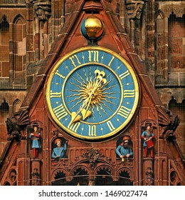 "Clock on catholic municipal church ""Unserer Lieben Frau"" (Our Dear Lady) in Nuremberg, Franconia, Bavaria, Germany. Golden fingers and numerals on blue clock face. Time on clock: 06:36"