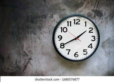 Clock on a Concrete Wall with Room for Copy
