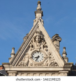 Clock on the gable of the Caisse d'Epargne building in Dijon, Franche-Compté, France