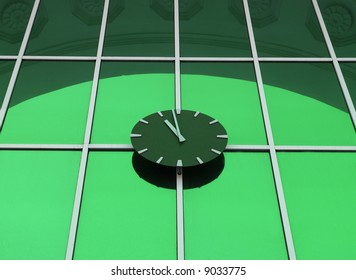 clock on a green background