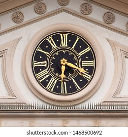 Clock on Gymnasium Hohenbaden (Upper Baden High School). Golden fingers and numerals on black clock face. Time on clock: 06h018