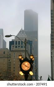 clock on pioneer square seattle in fog