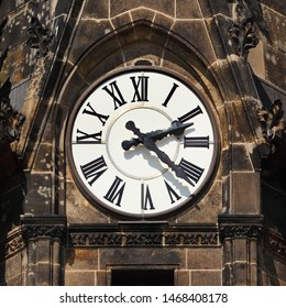 Clock on protestant church St. Peter in Leipzig, Germany. Black fingers and numbers on white clock face. Time on clock: 02h22