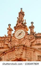 clock on Santa Prisca church in Taxco, Guerrero, Mexico