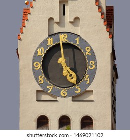 Clock on spire of protestant Erlöserkirche (Savior Church) in Munich Schwabing, Germany. Golden fingers and numerals. Clock face Jugendstil style. Time on clock: 04h59.