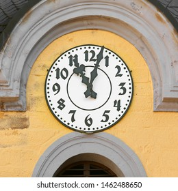 Clock on the steeple of the Hauptkirche Suhl (Main Church Suhl) in Suhl, Thuringia, Germany. Black fingers and numbers on white clock face. Time on clock: 11h03