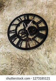 Clock on vintage plastered wall background