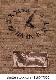Clock on wall in Rhodes Greece