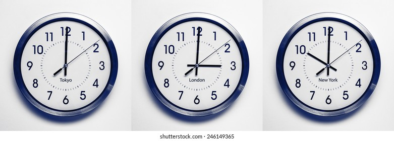 clock on the wall of time zones for trading around the world set at 3PM london GMT time. image is black and white with a blue tint