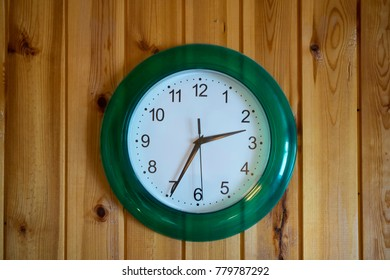 Clock on the wall of wooden planks