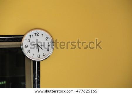 clock on wall yellow background watch stock photo edit now rh shutterstock com
