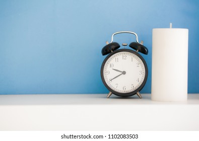 Clock on White table with blue background