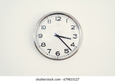 clock on white wall