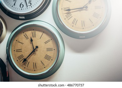 Clock on white wall background,Vintage effect,Concept of Time.