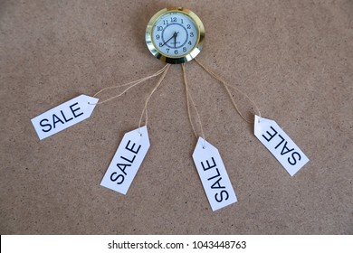 clock on the wooden background. Fashion,black friday and big sale concept.