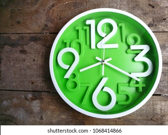 Clock on wooden background. The time is 8:20 am or pm. Eight twenty o'clock