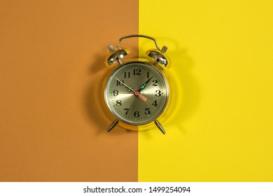 clock on yellow background with dial
