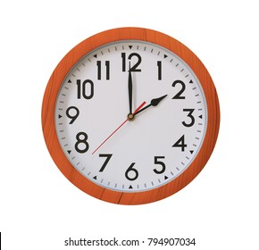 clock of pattern brown wood in two o'clock isolated on white background and have clipping paths .