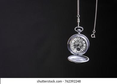 Clock pocket on a dark background