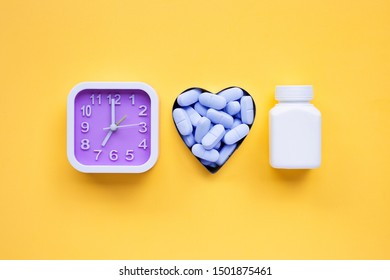 """Clock with """"PrEP"""" ( Pre-Exposure Prophylaxis). used to prevent HIV on yellow background. Top view"""
