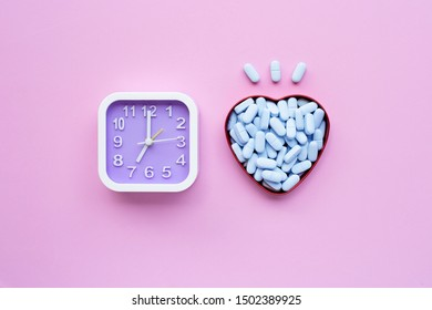 """Clock with """"PrEP"""" ( Pre-Exposure Prophylaxis). used to prevent HIV on pink background. Top view"""