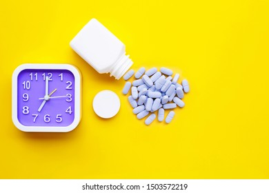 """Clock with """"PrEP"""" ( Pre-Exposure Prophylaxis). used to prevent HIV on yellow background. Copy space"""