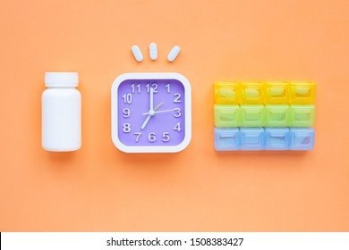 """Clock with """"PrEP"""" ( Pre-Exposure Prophylaxis). used to prevent HIV on orange background. Top view"""