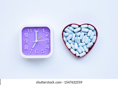 """Clock  with """"PrEP"""" ( Pre-Exposure Prophylaxis). used to prevent HIV. Top view"""