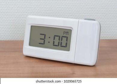 Clock radio on a desk - Time - 03.00 PM