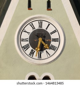 Clock of Roman Catholic Parish Church St. Jakob in Geiselhöring, Bavaria, Germany. Golden fingers, black numbers on black/white clock face. Time on clock: 04h32