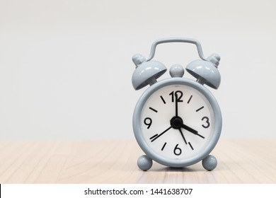 The clock show time is 4 o'clock or 4:00 pm