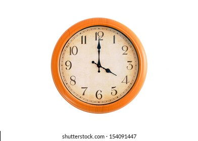 Clock showing 4 O'clock on a white wall