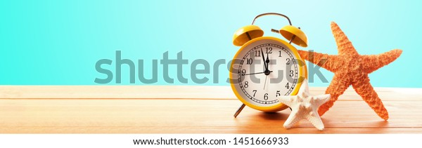 Clock showing nearly 12 on a blue background