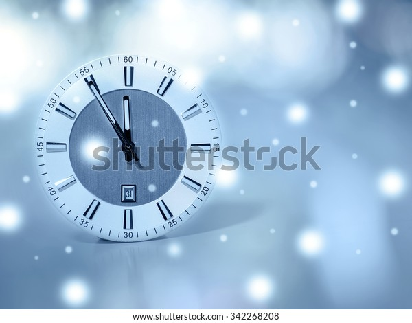 clock shows the approach of the new year