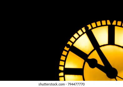 Clock silhouette at night.