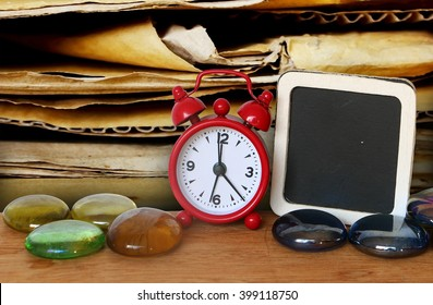 clock and small blackboad with old crepe paper background