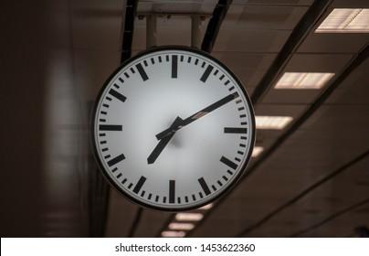 Clock time at 7:10 pm. Big white clock in underground train station. Bangkok, Thailand.